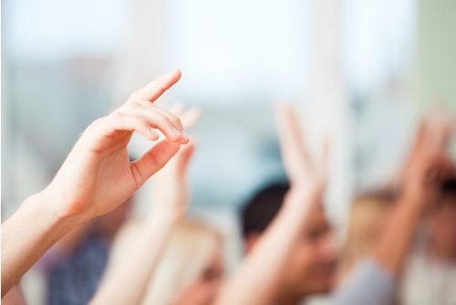 Student with hand up for question