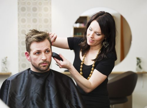 cosmetologist working in salon