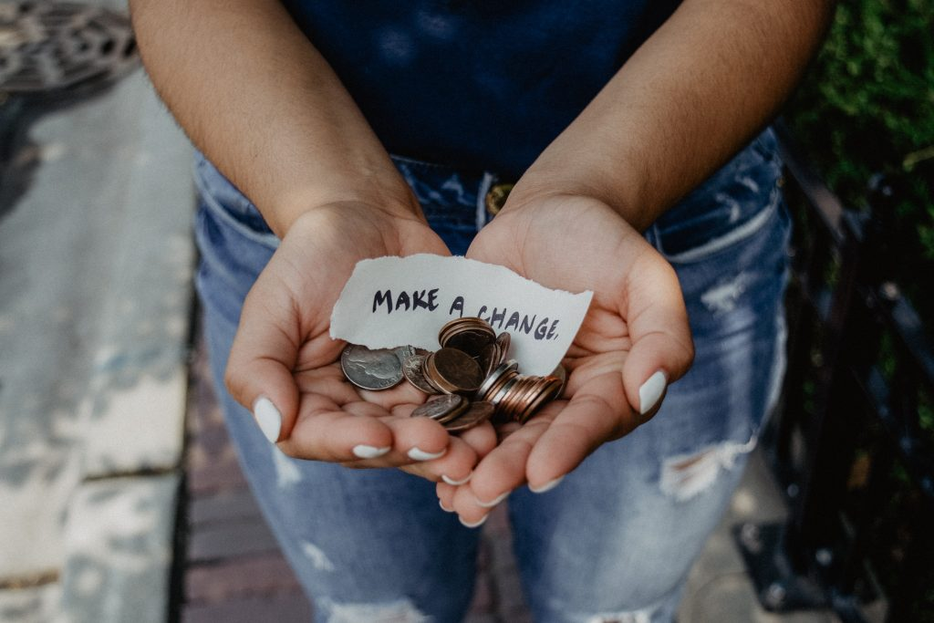 hands holding spare change